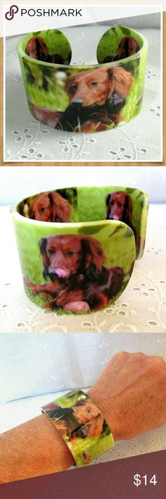 "Dachshund Dog Cuff Bracelet by Bonsny Adorable doxi in the grass. Acrylic cuff bracelet fits comfortably. See photo 6 for adjusting the cuff. I find they fit up to a 7 1/2"" wrist. Cuff is 1 1/2"" wide. The cuff has a high gloss finish that protects the design. Bonsny Jewelry Bracelets"