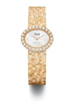 48b33cf4440 Piaget Extremely Lady - this 18K rose gold watch has a bezel set with 24  diamonds