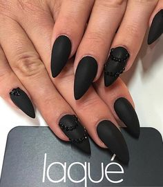 Black is always in fashion as the little black dress that all the ladies have in the closet. Even one. This extravagant manicure is for the courageous little lady, so if you're like that, go for it.