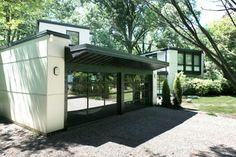 Modern Garage Door Cedar Soffits Dark Siding House