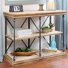 Mix and match your love of rustic and industrial styles with our Sonoma Two-Tier Console Table. This unique tables features natural, reclaimed wood shelves.