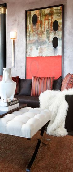 An IMPACT VERTICAL wall hanging vs the traditional horizontal hanging over the sofa is VERY IMPRESSIVE!! Makes a statement with the complimenting pillows, don't you think?  i love these particular wall sconces.  I used 4 of them in one of my client's large foyer, and they were stunning.