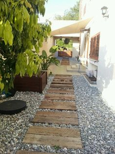 ready to change things up a little on your backyard and build a new secret garden, for instance, at the end of a nice and creative pallet walkway! Backyard Garden Design, Small Garden Design, Backyard Ideas, Diy Garden, Garden Paths, Garden Beds, Walkway Garden, Pallet Walkway, Wood Pathway