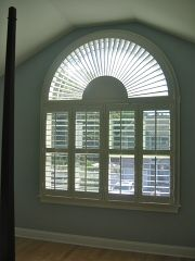 Composite Shutter with louver operated by traditional front tilt bar. Above the shutter is a custom made corneas shutter.