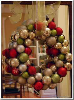 Christmas wreath made with Christmas balls - Love the ribbon and hanging it in front of a mirror idea