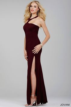 Sexy sleeveless gown with halter neckline, T-back, and featuring a side slit