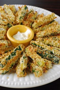 """Zucchini fries. Audrey says: Add the seasoning to the whole wheat flour because it falls to the bottom of the panko dish. Also, maybe let them """"sweat"""" for an hour like other recipes are saying. Made ranch dip with a packet of ranch seasoning, 1 cup milk, 1 cup mayonaise and 2 heaping big spoons of sour cream for thickness and to cut the Helmann's mayo flavor. DELICIOUS."""