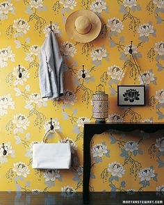 Pick a wallpaper with a repetitive pattern and let it dictate where you put wall hooks.
