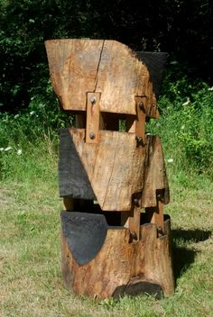 """""""Mended"""" abstract ash wood sculpture with shou sugi ban char finish and hickory mortise and tenon construction by Sam Soet."""