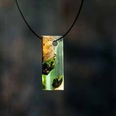 A personal favorite from my Etsy shop https://www.etsy.com/listing/246386453/burl-mango-and-resin-pendant-from-my