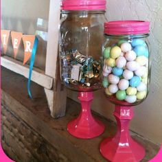 Buy 2 mason jars, and candle holders from the dollar store. Paint, Gorilla Glue.. BAM!  Behold, candy jars.