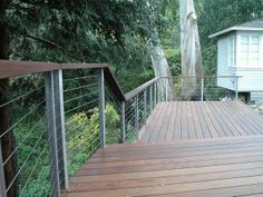 Welded Post Customer's Wood Top Rail with Cable Railing from Stainless Cable & Railing Inc