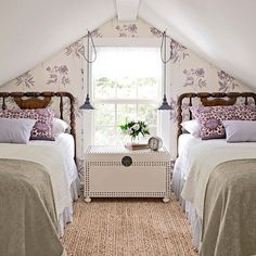 A lovely attic turned girls getaway! The hanging pendants are a great space saving alternative to traditional lamps. What's your favorite element here? via: @countrylivingmag
