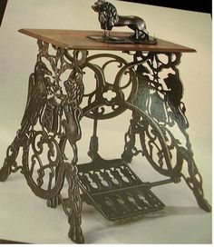 ~ antique sewing machine ~ (what an odd little fellow on top of such  beautiful ornate legs!) ~