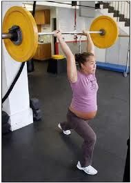 Pregnant and crossfit, this will be me...this is Annie a few years ago and then there is a pic of Annie at the 2011 CrossFit Games on this board! Amazing athlete!