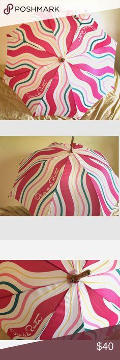 Vintage Umbrella, Oscar De La Renta Stay dry and look fly....this umbrella is designer fabulous. Retro Oscar de la Renta umbrella with light wood and gold metal accents. Swirls of pinks, green, yellow and white. Perfect vintage condition. I haven't seen a retro designer umbrella like this one 😍 Oscar de la Renta Accessories Umbrellas