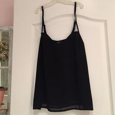 Black LF Top Has adjustable straps. Lined LF Tops