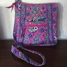 Vera Bradley Crossbody. Cute Vera that was used all the time. It looks lighter than when originally purchased.  Still in good shape structurally. Pretty purse. Vera Bradley Bags Crossbody Bags