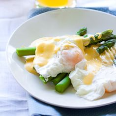 Poached eggs on Asparagus with Hollandaise. Delicious!