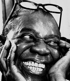 Louis Armstrong- What an infectious smile.