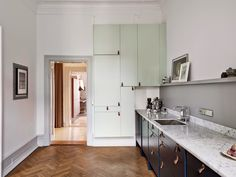 Fab two-tone kitchen and sitting room in a Swedish apartment. Entrance.