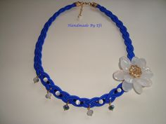 Short knitted necklace in electric blue with white flower and glass beads.  https://www.facebook.com/pages/Handmade-Creations-by-Efi/187659788043676