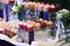 Cupcakes on glass blocks. Love the display idea