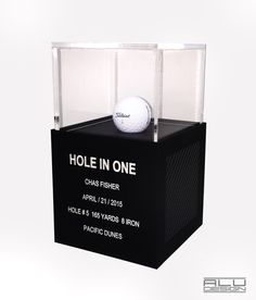 Modern contemporary HOLE-IN-ONE Golf Ball Display Cases CNC Machined Anodized Aluminum Clear Silver with Graphite Carbon Fiber Design. Golf Trophy Cases, Hole In One Plaques. Modern Golf Displays and Trophies. Made in the USA. Order on our website shipping worldwide. ALUDESIGNUS Golf Display luxury golf accessories Bandon Dunes Pacific Dunes HOLE IN ONE