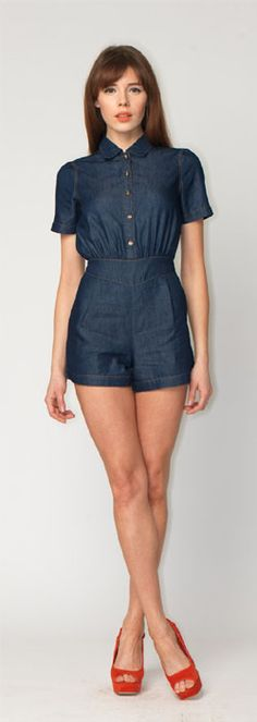 Dakota Denim Playsuit from Motel -   Shirt inspired chambray denim style Motel playsuit with button through front in a light navy blue. Featuring short sleeves, cinched in diamond shape waist and button up front with cute collar detail. Perfect for Autumn in lightweight cotton this playsuit looks great teamed with colour pop flatforms and a bare leg, dress up with a studded belt and tights for an evening look.    Fabric Content: 85% Cotton, 15% Polyester - $99