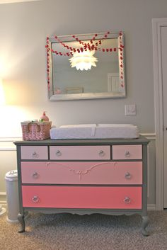 Popular PIN.  This antique dresser is painted pink ombre with a gray body - for a baby girls room.  Be inspired!  Visit Rescued Relics board on unique baby changing dressers - http://www.pinterest.com/corescuedrelics/unique-baby-changing-dressers-aka-tables/