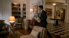 Daniel Grayson foyer-sitting room....This season, with Lydia (presumably) dead, the guest bedroom was freed up and turned into a cozy sitting/living room with a fireplace and built-in bookshelves.