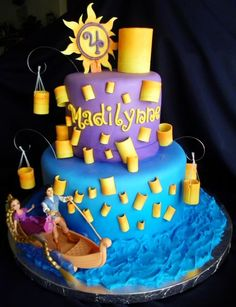 Great colors, love the lanterns...I could get the toy pieces for something like this Tangled cake