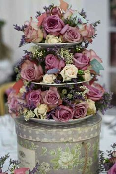Looks like a flower cake. Could use that beauty and the beast looking one as cake toper type thing instead of that tiny top tier