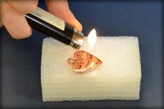Jewelry making tutorial: how to make a clear resin image pendant from www.rings-things.com.  Use a flame to rapidly raise bubbles to the surface.