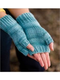 Aegean Mitts Easy fingerless mitts with a zigzag cable pattern and twisted stitches, worked in cashmere yarn. A knitted thumb, stockinette palms, and short length make these a sweet little pair.