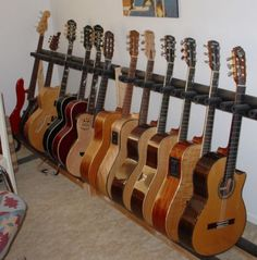 I really need this in my dream house just for my master bedroom. I want to have a place to organize all of my guitars and this rack would no doubt help me. All guitars get stacked nicely, facing the front for if I ever want to pick one up and just jam out for house. A must have for any musicians room.