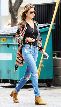 Alessandra Ambrosio is seen in ripped blue jeans, black tank top, printed cardigan, and suede flat booties.