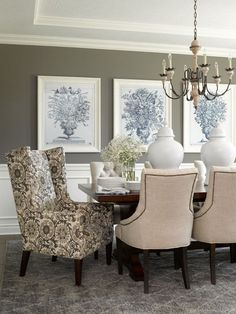 dining room walls in deep gray provide background for a grouping of large-scale art #FormalDiningRooms