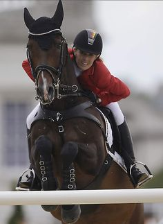 Germany's Janne Friederike Meyer rides Lambrasco during the equestrian show jumping competition at the 2012 Summer Olympics, Monday, Aug. 6, 2012, in London. (AP Photo/David Goldman)