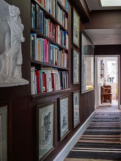 bookshelves and art line hallway of Ben Pentreath's London flat ... very English style, (change the paint colour, rest is great)