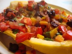Yellow squash stuffed with vegetables and cheese makes a light summer supper