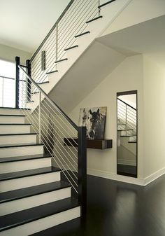 Love dark wood and white staircases