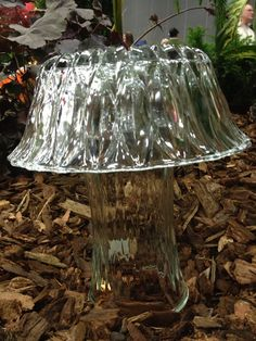 Mushrooms for the garden! = glass vases and bowls.