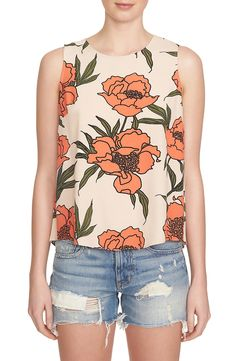 In love with this fun floral tank that is styled with a subtle back cutout and slender keyhole.