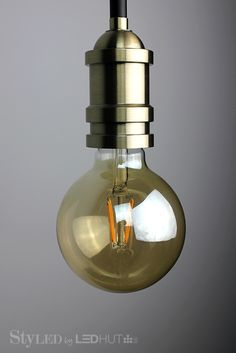Why LED Filament Bulbs are Becoming Every Interior Designer's Trendiest Accessory this Year D Lighting, Trendy Accessories, Incandescent Bulbs, Ranges, Workplace, Light Bulb, Sconces, Wall Lights, Led