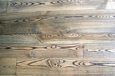 Ash floors are known for their prominent bold grain, made even more pronounced with the application of a dark stain.