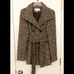 """️HP 1/9Calvin Klein Wool Blend Peacoat This coat is a 2 Petite, but I am a size 2 in coats and it fits me perfectly. This coat is black, white and grey. You can see the color detail best in the last photo. It has buttons and a fabric belt to keep you bundled up. It has been worn a few times and is in excellent condition. It is approximately 17"""" from armpit to armpit when buttoned. It is approximately 27"""" from shoulder to hem with 24"""" long sleeves. The shell is:  40% wool, 30% polyester, 25%…"""