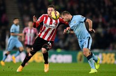 Pablo Zabaleta of Manchester City heads the ball clear as Connor Wickham of Sunderland closes in during the Barclays Premier League match between Sunderland and Manchester City at The Stadium of Light on December 3, 2014 in Sunderland, England.