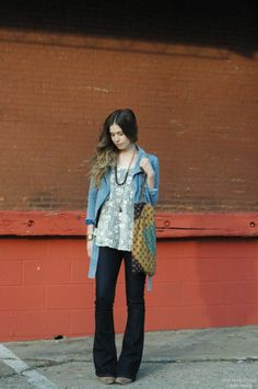 Orchid Grey 1970s boho look. Flair jeans, lace top, and denim jacket