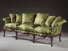 A fine George III period carved mahogany sofa